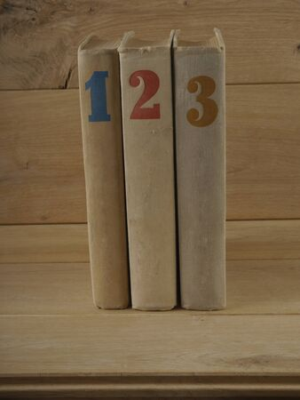 Three books on wood backgraund closeup gray photo