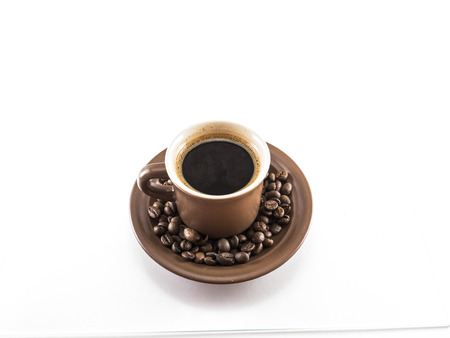 isoleted: Cup of coffee with beans on isoleted beckgraund Stock Photo