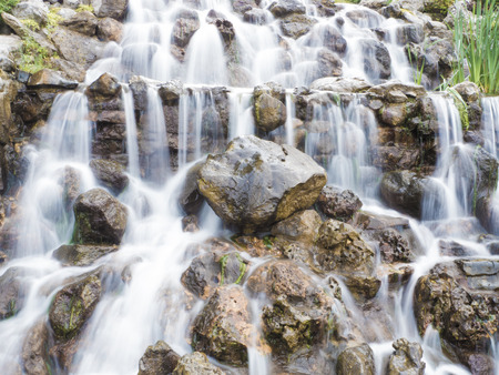 Image of waterfall with stones in the evening. photo