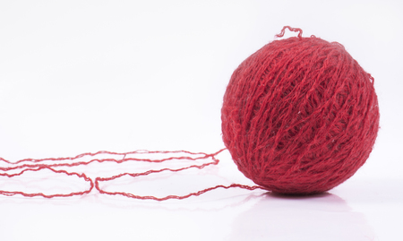 wool ball: Image of red wool ball, isolated close up. Stock Photo
