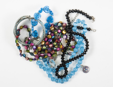 Image of jawalery bracelet, necklaces, earrings blue isolated photo