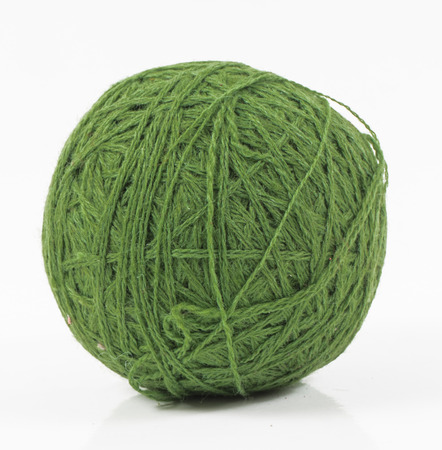 wool ball: image of green wool ball isolated close up