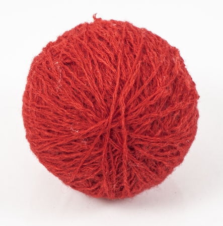 wool ball: image of red wool ball isolated close up