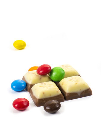 dragee: Image of dragee and chocolate pieces white and brown isolated.