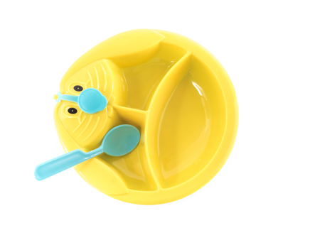 baby cutlery: Image of childrens dishes isolated close-up.