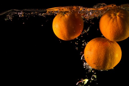 Mandarins in the water Stock Photo
