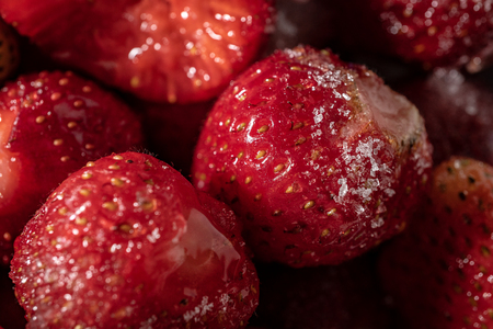 Strawberry berries sprinkled with sugar closeup