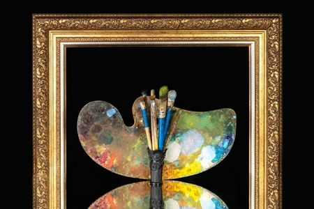artistic brushes palette in picture frame on a black background Imagens