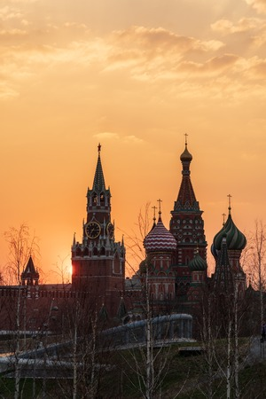Moscow Kremlin and St Basils Cathedral at sunset, Russia.
