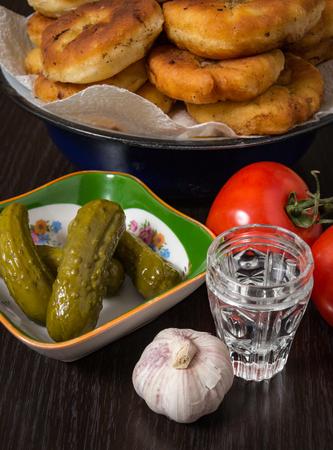 Belyashi, Tomatoes, Pickled cucumbers, Garlic, Vodka glass
