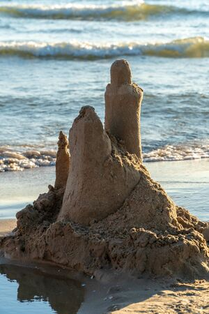 Sand castle on the beach, summer sunny day. Reklamní fotografie