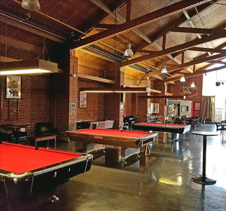 Billiard tables in a recreational room Imagens