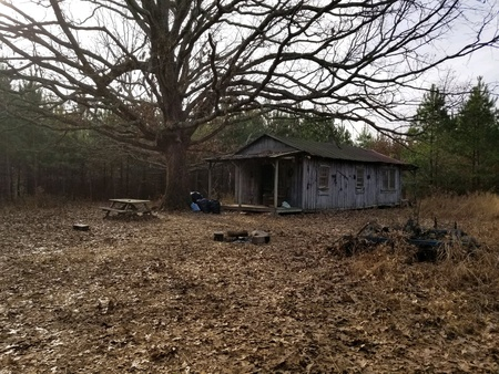 An old dilapidated wood house