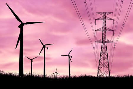 Silhouettes of wind turbines and high-voltage poles in a field at sunset. Standard-Bild