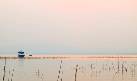 ratchasima: Sunset of reservoir Lumtakong, Amphoe Sikhiu, Nakhon Ratchasima, Thailand.