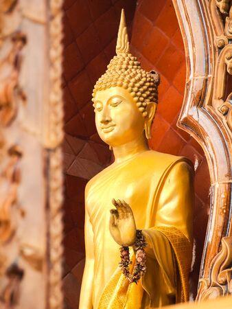 godhead: Standing Buddha status . Buddha image style pagoda. Stock Photo