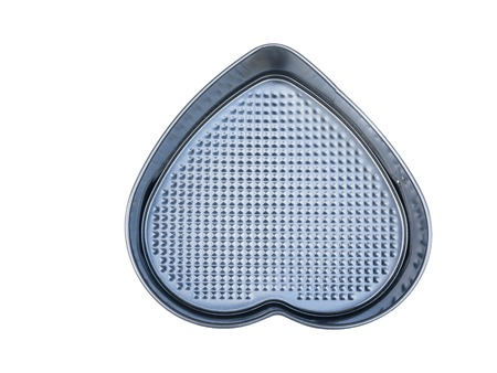nonstick: material heart-shaped baking loaf pan non-stick coating. isolated on white.