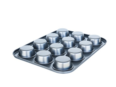 nonstick: Baking muffins tray 12th hole. non-stick coating. isolated on white. Stock Photo