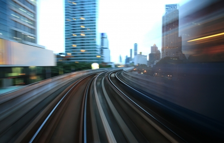 Motion blurred on speeding sky train   photo