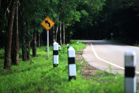 curvaceous: Curve road sign on down hill  Stock Photo