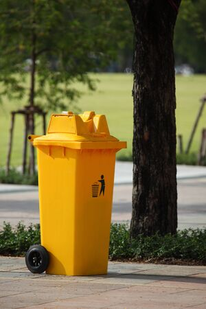 trash can yellow in park  photo