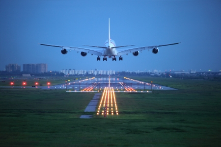 passenger plane fly up over take-off runway from airport Stock Photo