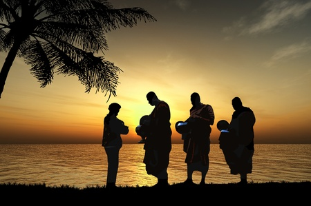 hin: Silhouettes of monks on the beach, Thailand