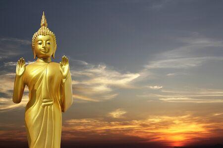 zen like: Buddha statue at sunset  Rear view  Stock Photo