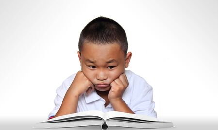 frustrated student: Young boy thinking