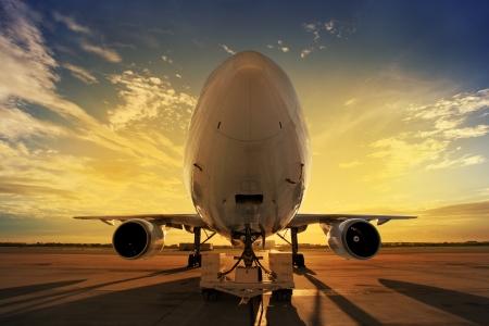 back lit: Airplane at sunset - back lit