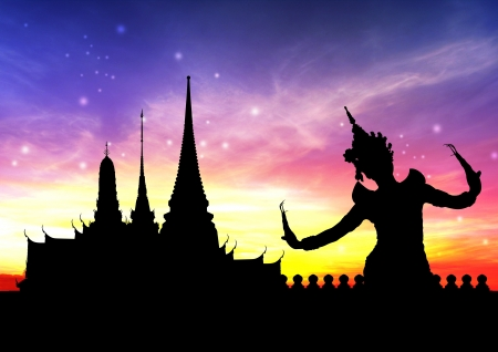 thai dance perform by young woman silhouetted with temple in thailand background
