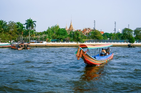 Boat on Chao Phraya river , Bangkok, Thailand photo