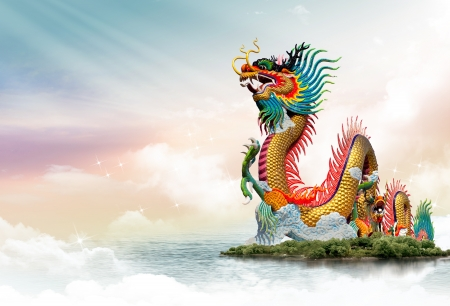 china dragon: Chinese dragon at sunset in the background Stock Photo