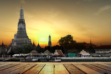 wat arun: Concept, wat arun in sunset and wood planks floor Stock Photo