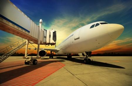 Airplane at sunset - back lit Imagens - 23109287