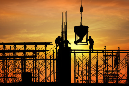 silhouette of construction worker on construction site Imagens