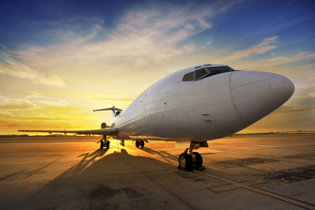 airport runway: Business plane at sunset - back lit
