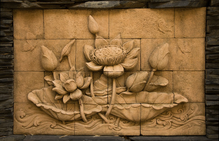 stone carving: A stone inscription of a flower, Thai style of buddhism Stock Photo