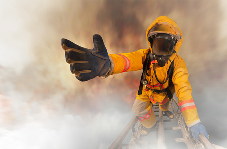 fire safety: Firefighters rescued the survivors Stock Photo