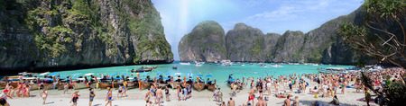 phi phi: PHI PHI ISLAND,THAILAND-JANUARY 3, 2015:Tourists on the wonderful Maya beach of Phi Phi Leh island Thailand on 3 January, 2015. Editorial