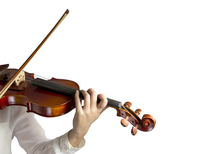 Hand on the strings of a violin over white background