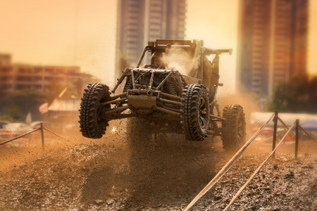 Wheels of a four wheel drive vehicle off the ground