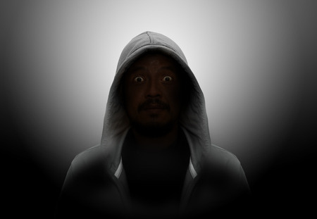 hooded shirt: Silhouette of man in the hood