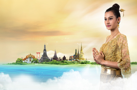 Thai Lady in vintage original Thailand attire Sawasdee action welcome in thai style Stock Photo