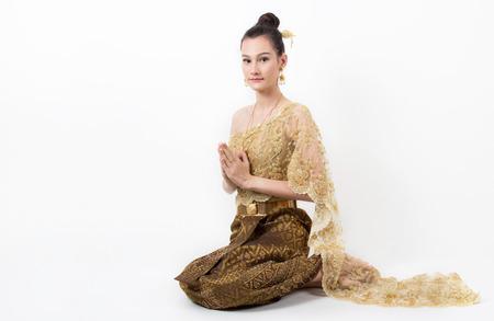 hai Lady in vintage original Thailand attire Sawasdee action welcome in thai style Stock Photo