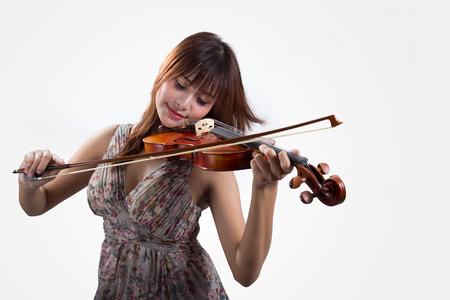 Mooie jonge vrouw spelen viool Stockfoto