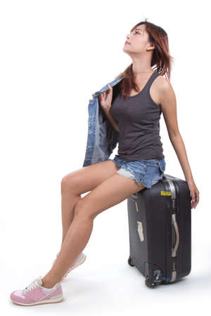 sexy asian girl: Woman traveller with suitcase isolated on white Stock Photo