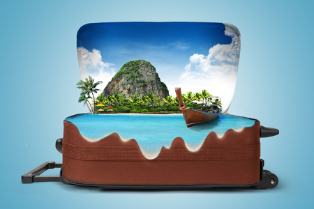 paradise beach: Open suitcase with a tropical island inside. Traveling