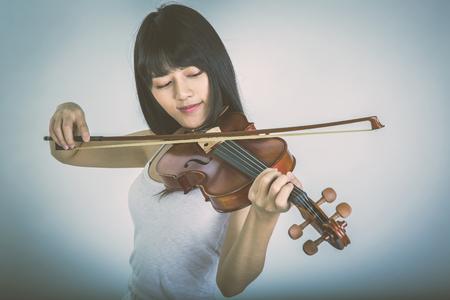 beautiful girl playing the violin
