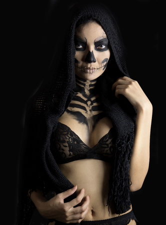sexy costume: woman in day of the dead mask skull face art. Halloween face art Stock Photo
